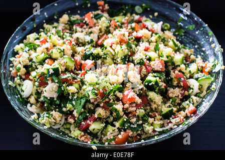 tabbouleh made of couscous and various vegetables - Stock Photo