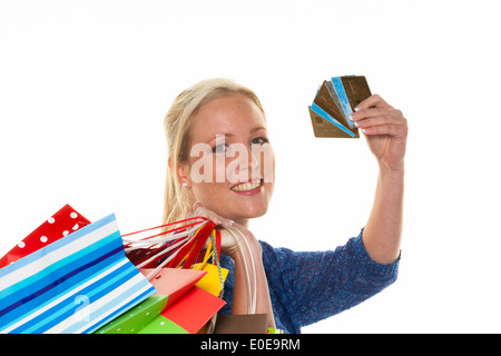 A young woman comes back with many carrier bags of the shopping. With credit cards and plastic money, Eine junge - Stock Photo