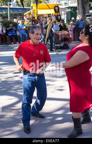 Los Angeles California CA L.A. Olvera Street Los Angeles Plaza Historic District Mexican heritage Hispanic man woman - Stock Photo