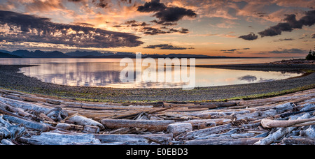 Sunrise over Discovery Islands, Coast Mountains in dist, Rebecca Spit Provincial Marine Park, Quadra Island, British - Stock Photo