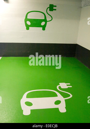 Electric car logos at a charging point - Stock Photo