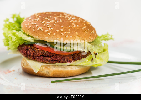 vegetarian burger with vegetables and grain cutlet - Stock Photo