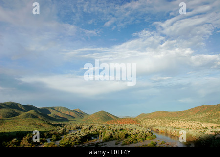 View over the Kunene river that forms the border between Namibia and Angola, southern Africa - Stock Photo