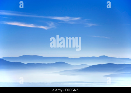 Blue sky above the Pagasitic Gulf and the mountains of mainland Greece - Stock Photo