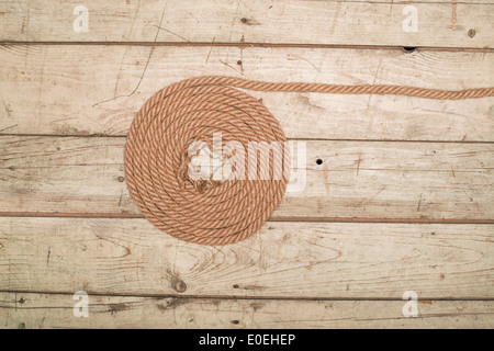 old texture of wooden boards with ship rope - Stock Photo