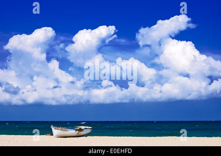 Boat lying on Potistika Beach (Pelion Peninsula, Thessaly, Greece) - Stock Photo