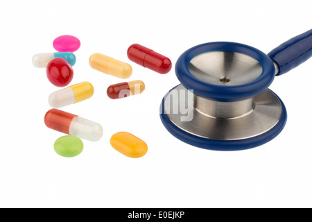 Coloured tablets and a Stethoskop, symbolic photo for diagnostics, heart deseases and interaction, Bunte Tabletten - Stock Photo