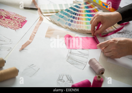 fashion designers, working in progress on tailor table - Stock Photo