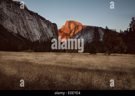 Half Dome at Sunset from field in Yosemite National Park - Stock Photo