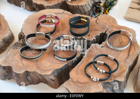 bracelets of precious stones on a wooden trunk - Stock Photo