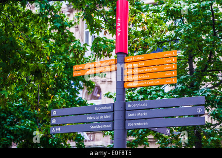 Signpost showing directions and walking times to various places of interest in Antwerp, belgium. - Stock Photo