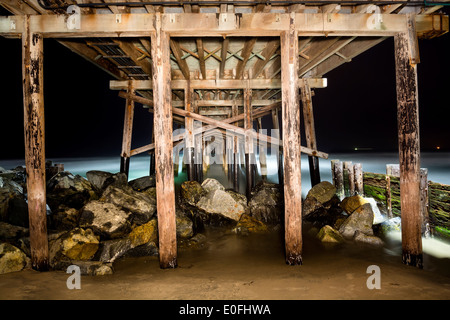 A light painted image of Balboa Pier underside taken at 4:00 AM with a slow exposure shows the intricate detail - Stock Photo