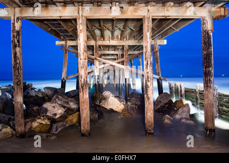 An image of the Balboa Pier in Orange County California early in the morning shows the structural detail and surrounding - Stock Photo