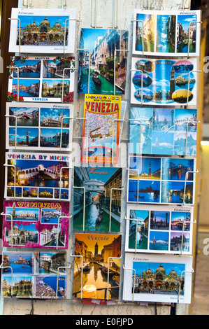 Venice Italy postcards and tourist map display - Stock Photo