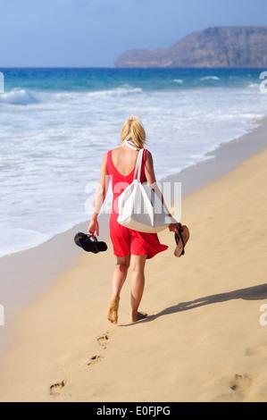 Girl walking on the beach in in Porto Santo - Stock Photo