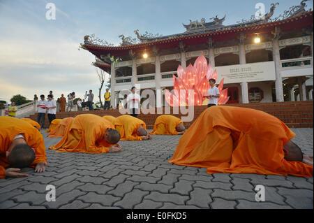 Singapore. 12th May, 2014. Monks attend the celebration on the eve of Vesak Day in Singapore, May 12, 2014. Vesak - Stock Photo