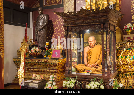 Life-like statue of a revered Monk, Wat Chedi Luang, Chiang Mai, Thailand - Stock Photo