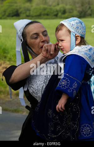A mother and her daughter in traditional costume from Plougastel Brittany France - Stock Photo
