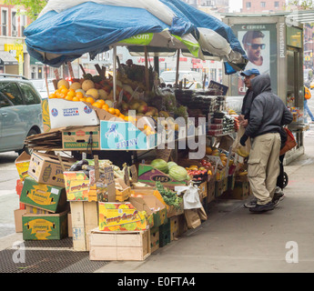 Fruit and vegetable stand in the New York neighborhood of Chelsea on Saturday, May 10, 2014. (© Richard B. Levine) - Stock Photo