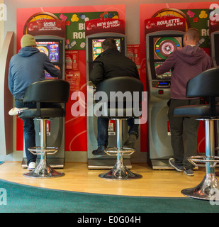 Fixed odds gaming machines (FOBT fixed odds betting terminal) in Ladbrokes Betting shop. UK - Stock Photo