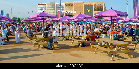 Picnic Benches And Parasols In The London 2012 Olympic Park With Temporary McDonalds Store Beyond