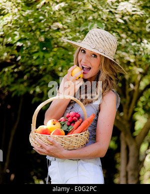 Woman with fruit and vegetables in the basket with woman, Frau mit Obst und Gemuese im Korb mit Frau - Stock Photo