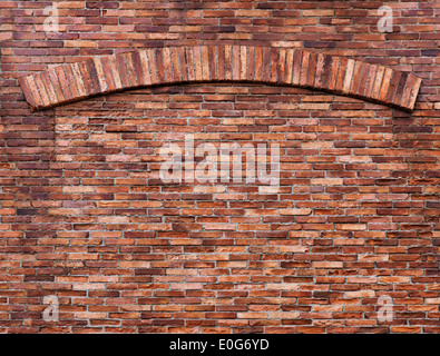 Texture of old red brick wall with an arch, grungy background - Stock Photo