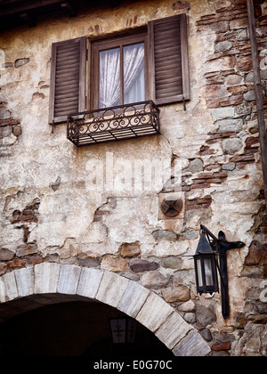 Old rustic house window, antique architecture in Venetian style - Stock Photo