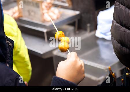 Curried fish balls - a popular Hong Kong street food - Stock Photo