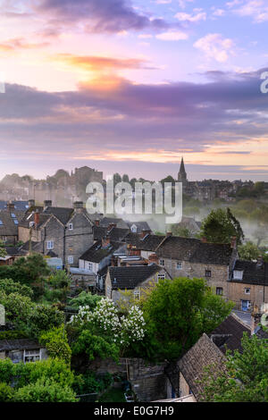 Malmesbury, Wiltshire, UK. 13th May, 2014. A misty sunrise in May over, the rooftops of the Wiltshire hillside town - Stock Photo