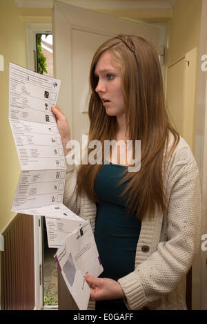 Silchester, Hampshire, UK. 12th May, 2014. Postal ballot for the May European Parliament Elections arrives. Teenage - Stock Photo