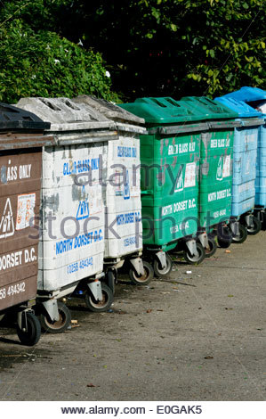 Line Of Local Council wheelie bins in Blandford Forum, Dorset, England - Stock Photo