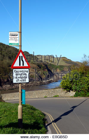 Traffic sign attached to the bus stop on the coast road at Hope Cove, South Devon, England - Stock Photo