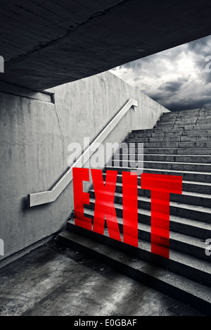 Exit on Urban staircase in underground passage with exit to dark stormy sky. - Stock Photo