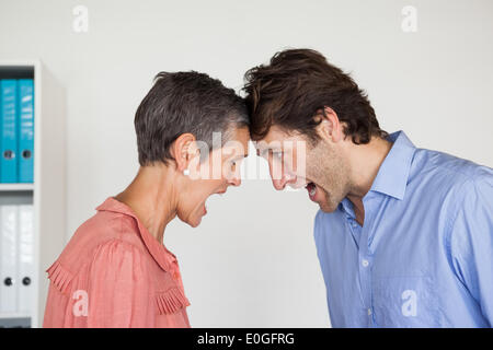 Angry business people shouting at each other - Stock Photo