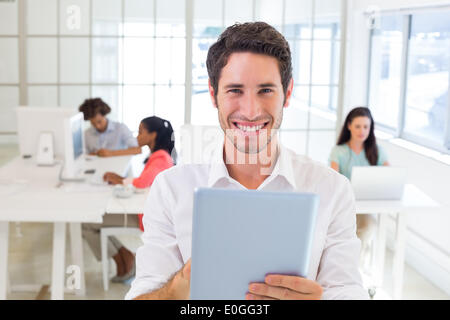 Businessman working on tablet pc - Stock Photo