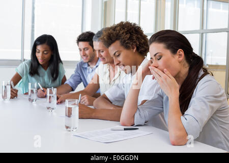 Business people yawning and being bored - Stock Photo
