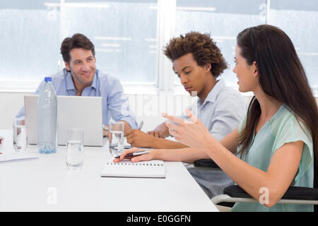Attractive business people at meeting - Stock Photo
