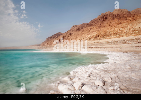 Salt deposit at the shore of the Dead Sea, crystal clear water and rough rocks, Jordan, long time exposure, Middle East, Asia Stock Photo