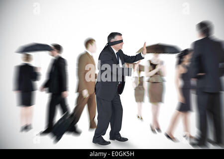 Composite image of mature businessman in a blindfold - Stock Photo