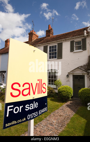 England, Berkshire, Bray Village, Ferry Road, Savills estate agents sign outside cottage for sale - Stock Photo