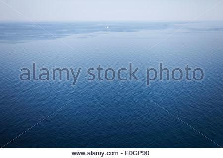 View over Baltic sea, little saling boat, Jasmund Peninsula, Island of Ruegen, Mecklenburg West-Pomerania, Germany - Stock Photo