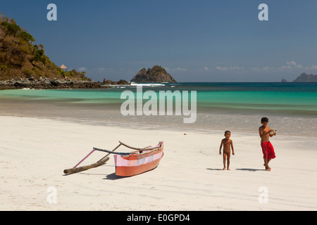 Indonesia, Lombok, South Coast, Seong Blanak, two young boys on the beach - Stock Photo