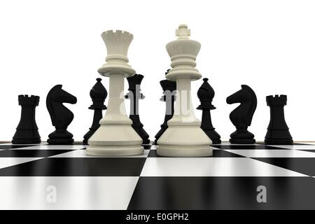 White king and queen standing in front of black pieces - Stock Photo