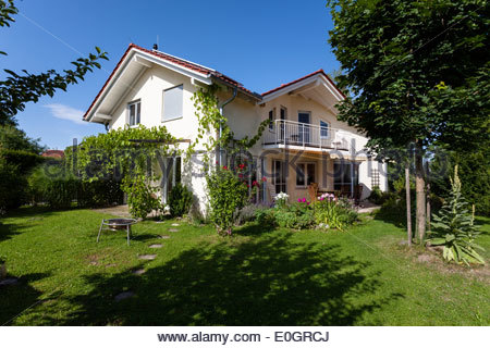 detached family house with garden in summer, Upper Bavaria, Germany - Stock Photo