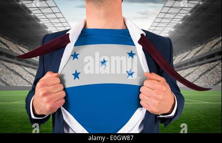Businessman opening shirt to reveal honduras flag - Stock Photo