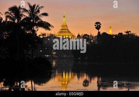 View on the Shwedagon Pagoda from Kandawgyi lake, Yangon, Myanmar, Burma, Asia - Stock Photo