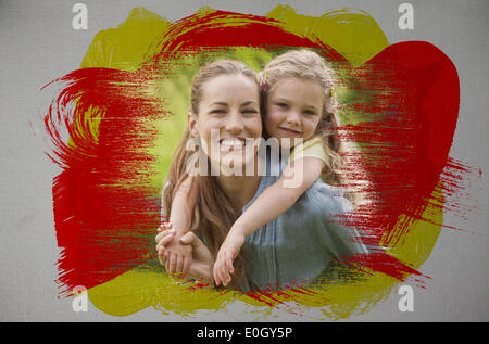 Composite image of smiling mother and daughter in the park - Stock Photo