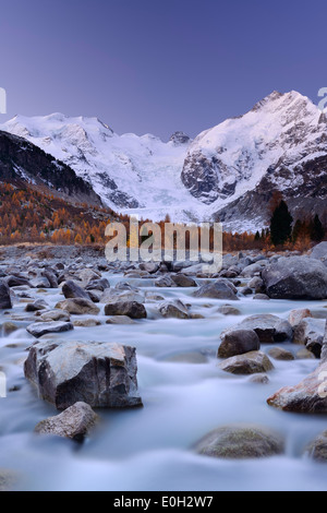 River flowing through Morteratsch valley at dawn with Bernina range in the background, Bernina range, Engadin, Grisons, - Stock Photo