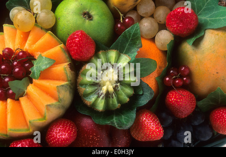 Variety of fruits, kiwi, grapes, melon, red currants, strawberries, pear - Stock Photo